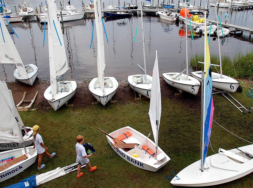 sailboats at bow to stern