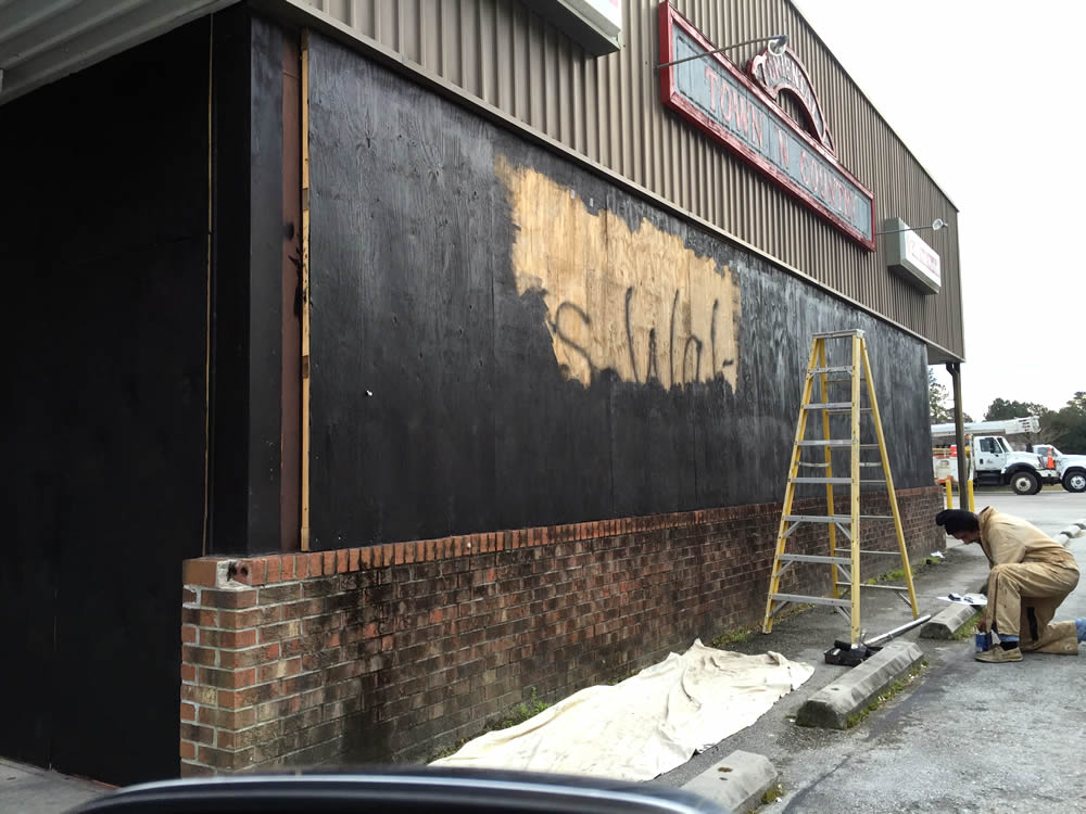graffiti being painted over
