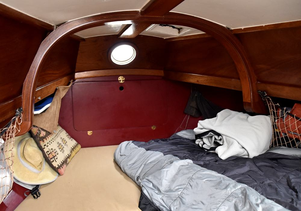 Inside <em>Annie's</em> cabin is small, with a sleeping bag laid out on one side of the berth.