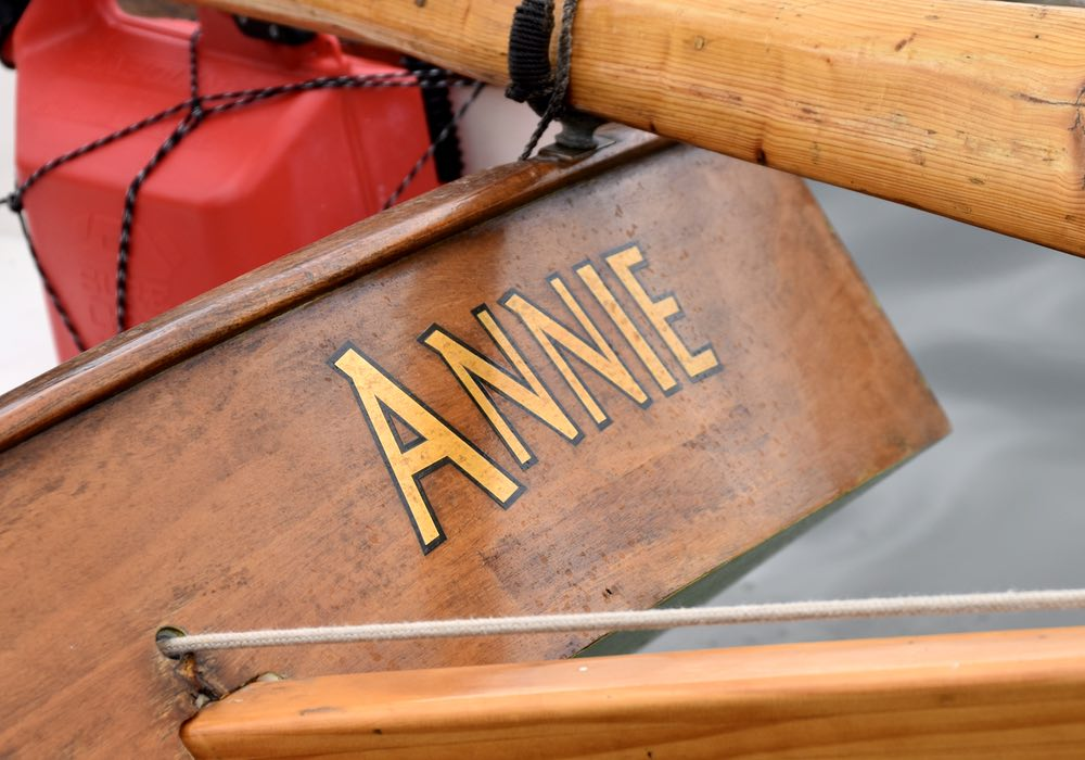Annie is stenciled in gold with a thin black outline on the transom.