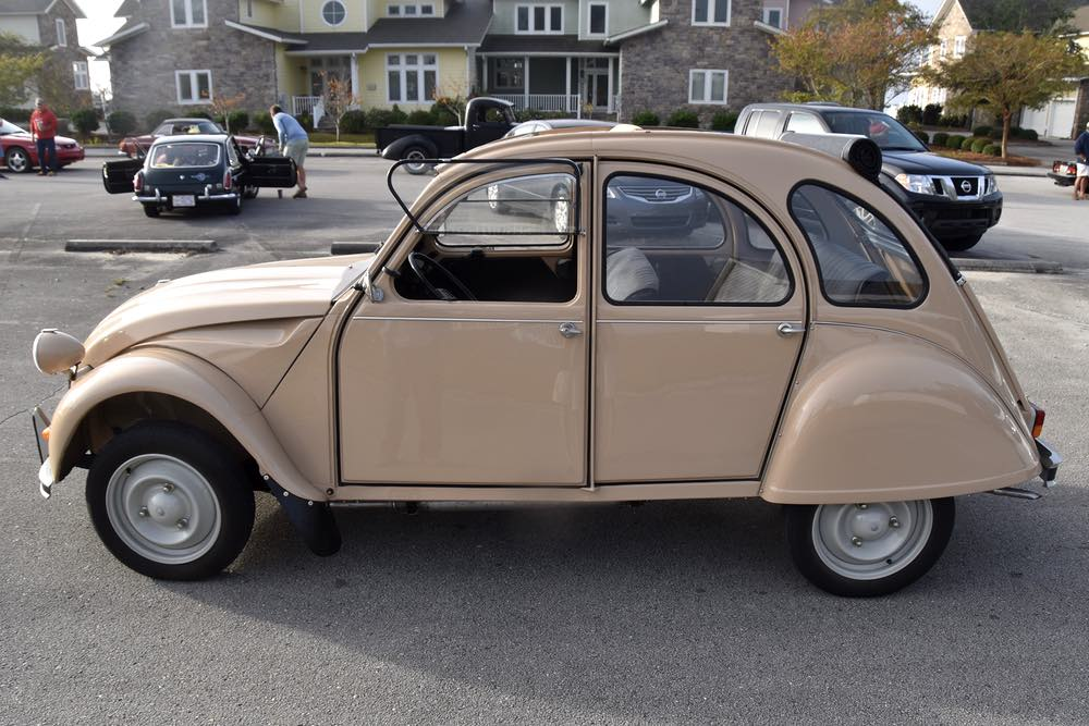 Side view of a parked beige Citroen from the '80s.